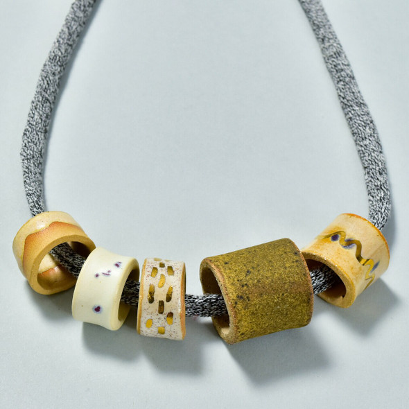 Five Bead Necklace by Curious Clay, close up of ceramic beads