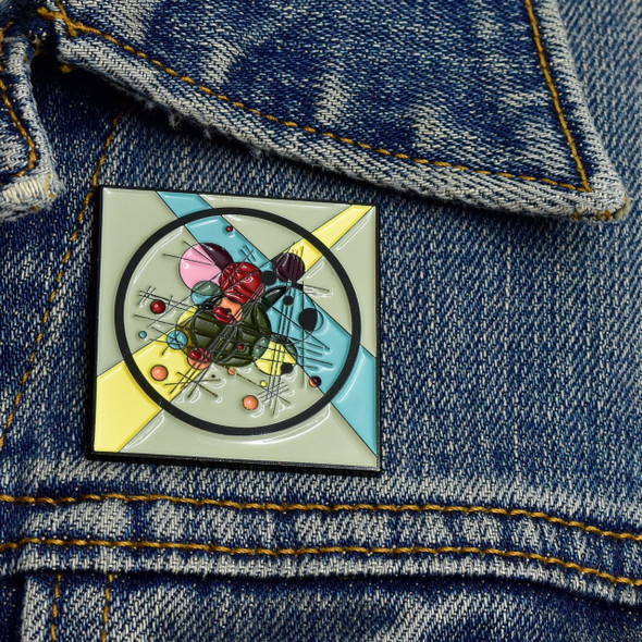Kandinsky Circles in a Circle Enamel Pin on denim jacket