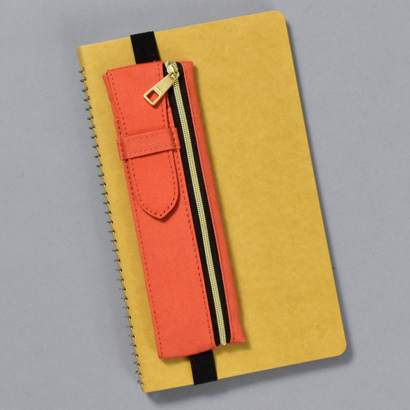 Midori Book Band Pen Case, on notebook