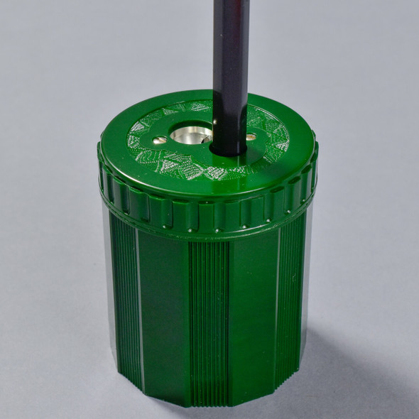 Dux Double-Hole Sharpener, with pencil being sharpened