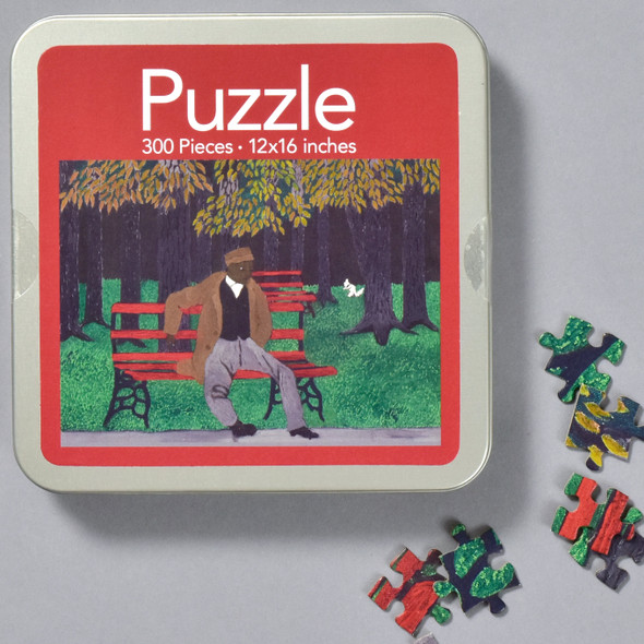 Horace Pippin: The Park Bench (Man on a Bench) Puzzle, front of tin with pieces