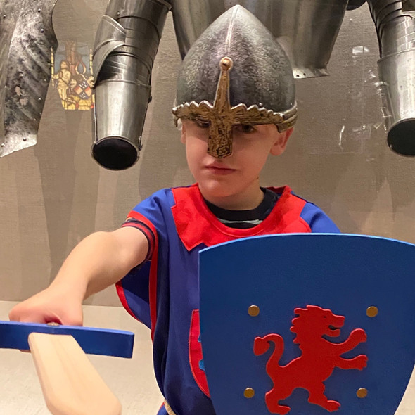 Child wearing Norman Helmet