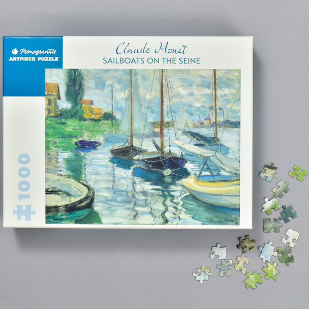 Claude Monet: Sailboats on the Seine Puzzle, box with puzzle pieces