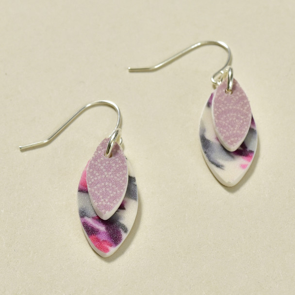 Purple Kitsune Polymer Earrings; laying flat