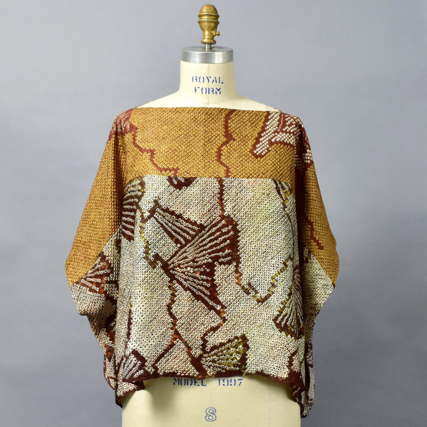 One Of A Kind Brown Silk Shibori Blouse on mannequin