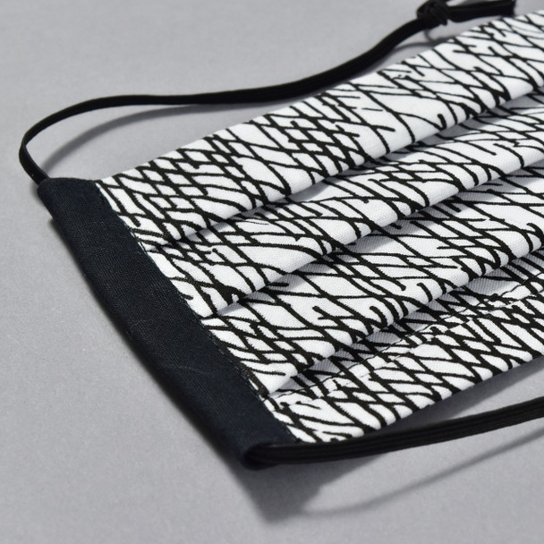 Pleated Black and White Face Mask by Lobo Mau close up