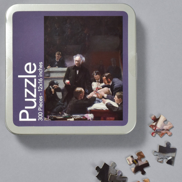 Thomas Eakins Portrait of Dr. Samuel D. Gross (The Gross Clinic) Puzzle, front of tin with pieces