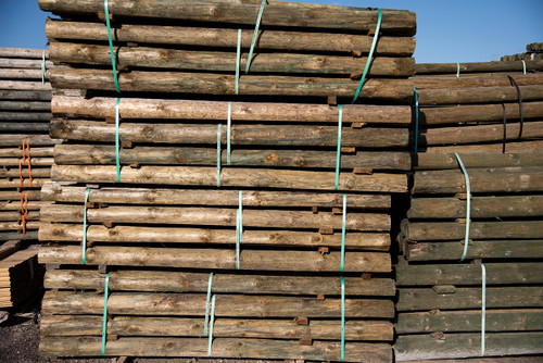 3.5x8 treated round wood post bundles