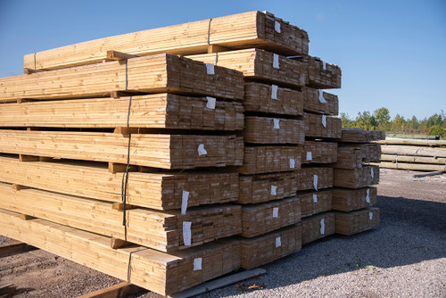 Treated wood boards for fencing