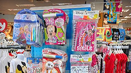 Kid's Retail Merchandise Pops on Blue Pegboard