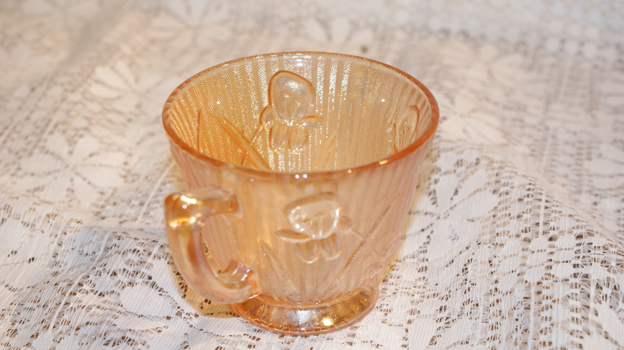 Jeanette marigold glass cups and saucers