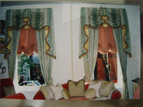 "Swags & Tails traditional window treatments lined and interlined bespoke.  Treatment consists of 2 swags / 2 tails / one fishtail in the center and 1 pair of curtains.  Swags and tails with trim and a contrast silk fabric.  Balloon shade place inside the window's architrave.  Custom fabrics presented by us or by the client can be used to compliment your decor'.  ""Feel at Home'"