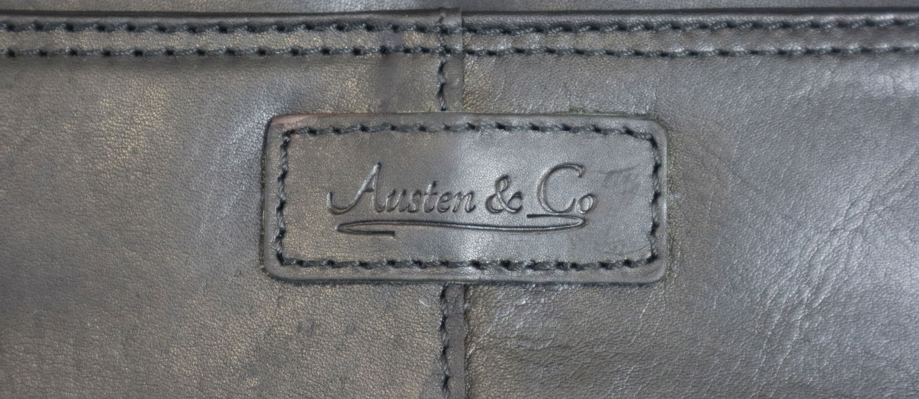 Black Briefcase Austen & Co Logo