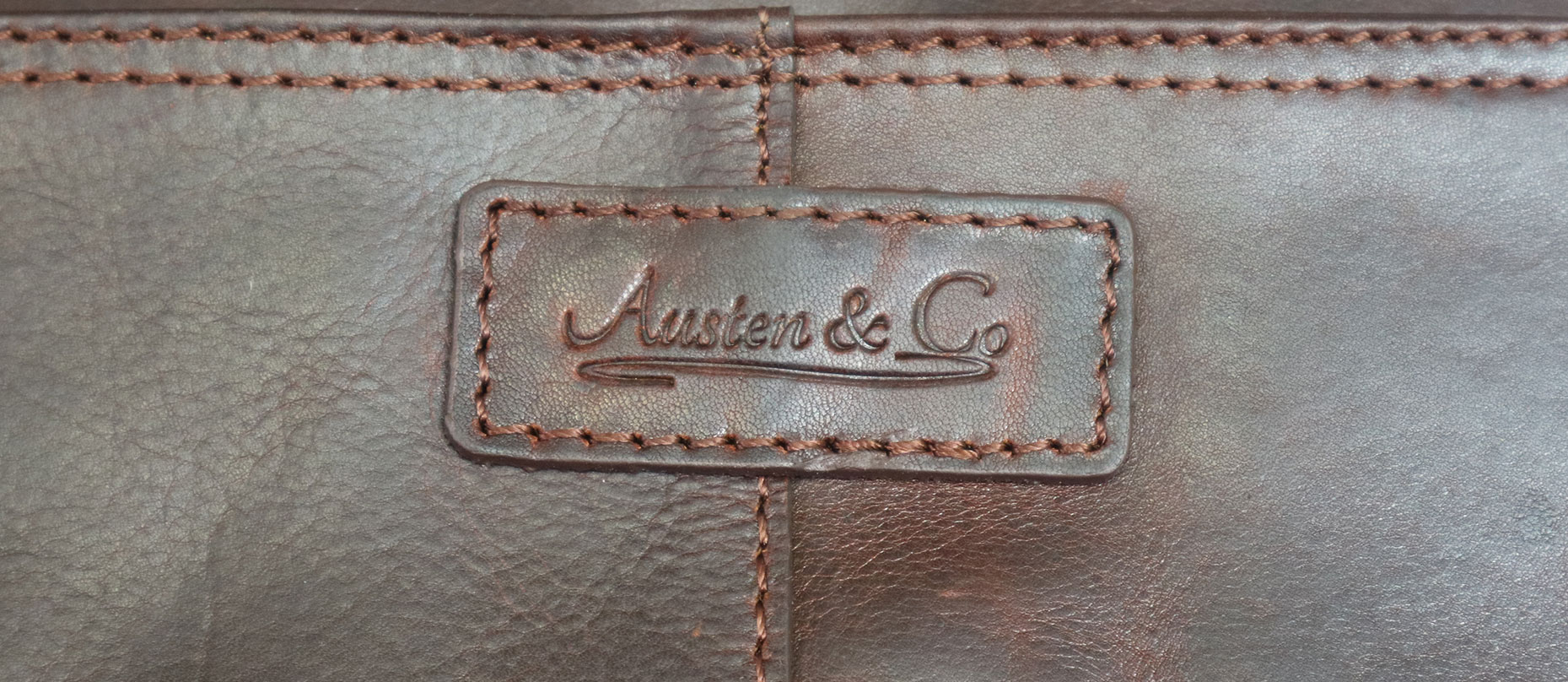 Brown Briefcase Austen & Co Logo