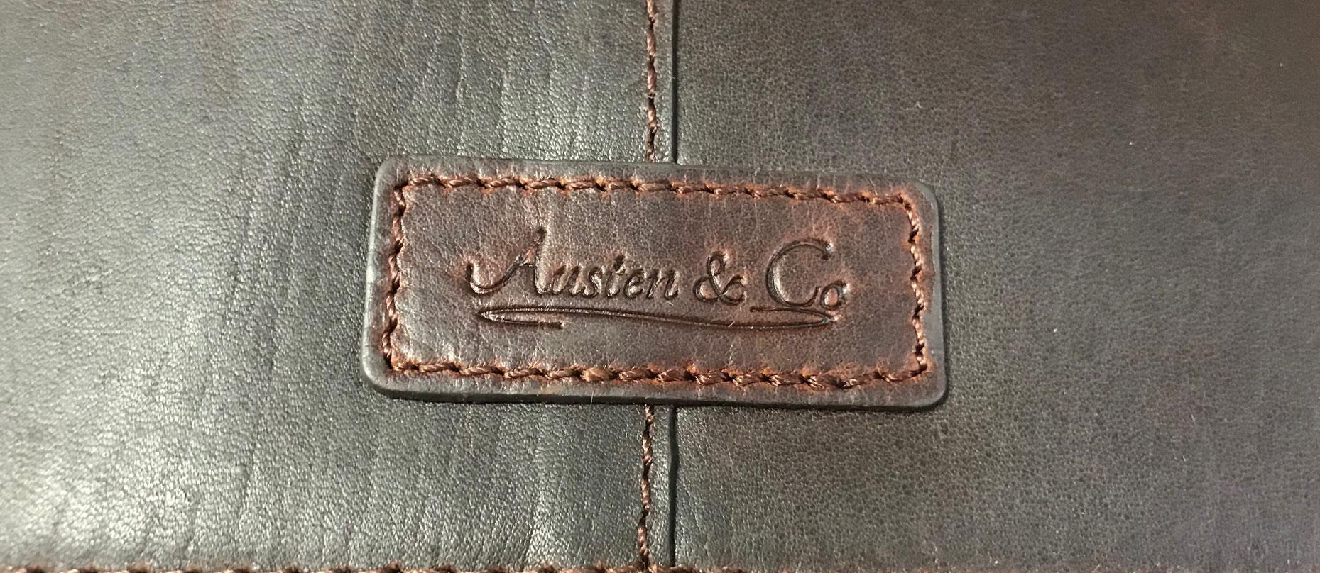 Brown Suit Carrier Austen & Co Logo