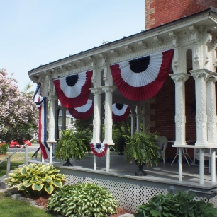 3 stripe red, white, and blue pleated fan on a porch