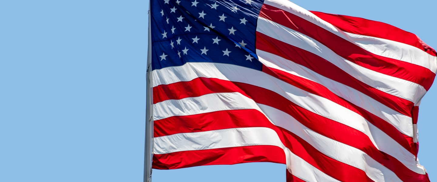 American Flag with a blue sky