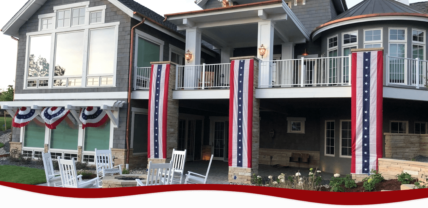 Red, white, and blue pull down banners hanging from balcony
