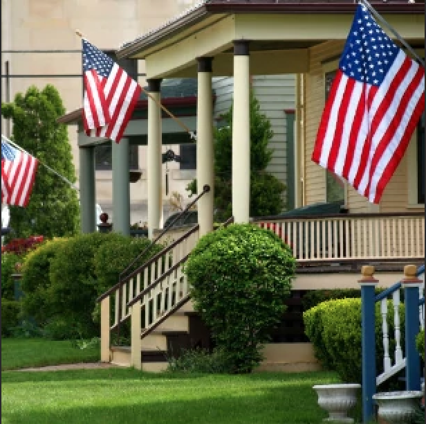 American Flags displayed on a porch