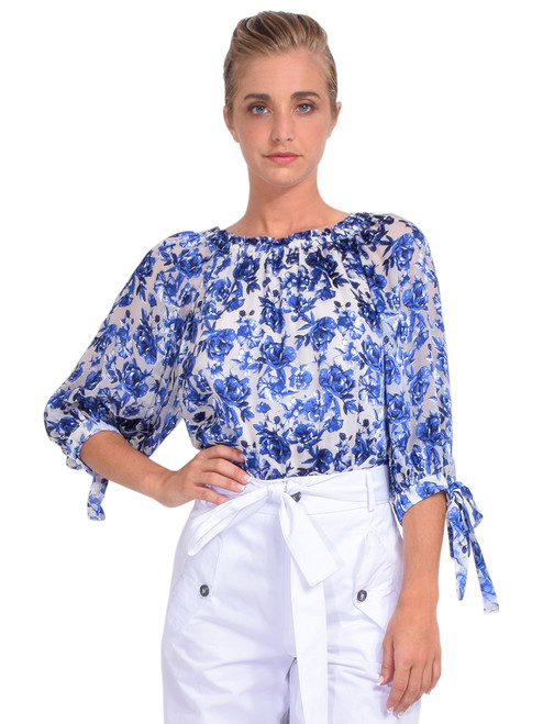 Alice + Olivia Alta Floral Off-The-Shoulder Blouse Front View x1https://cdn11.bigcommerce.com/s-3wu6n/products/33886/images/112723/DSC_0521_Full__60407.1618452474.244.365.jpg?c=2x2