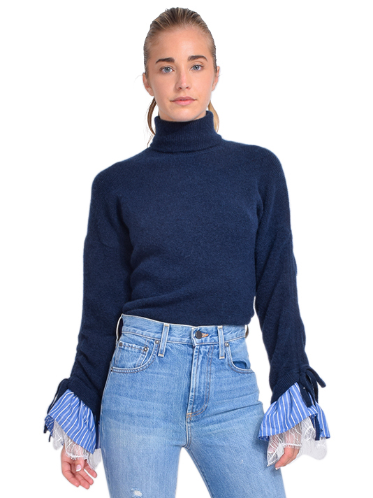 Cinq à Sept Atlas Turtleneck Sweater Front View X1https://cdn11.bigcommerce.com/s-3wu6n/products/33637/images/111491/DSC_0413_Full__71664.1608690874.244.365.jpg?c=2X2