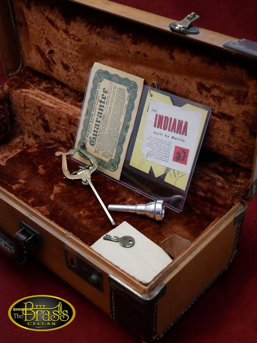 Original accessories for a Martin Indiana Cornet