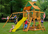 Outdoor shot of Chateau Wood Play set  with yellow slide option from Gorilla Playsets