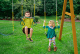 Kids swinging on Swing Belts from Gorilla Playsets