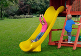 Lifestyle shot of Yellow Super Scoop Slide from Gorilla Playsets