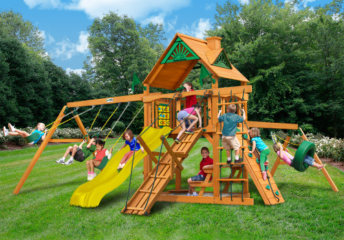Outdoor shot  of Frontier Playset  with yellow slide from Gorilla Playsets