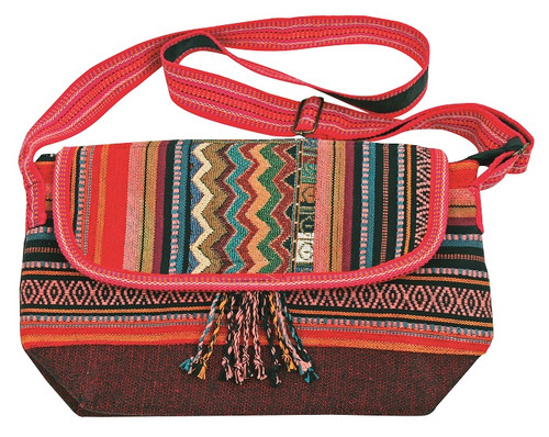 Cool purse with hand loomed material in patch work design. Small flap zipper close Adjustable Strap