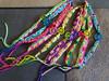 Assorted macrame dreamcatcher bracelets in various colors