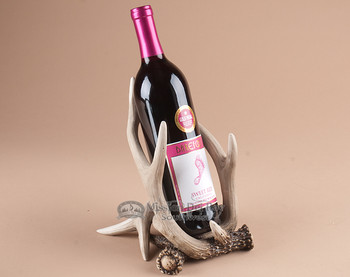 Single faux antler wine rack.