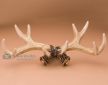 Faux antler wall rack art.