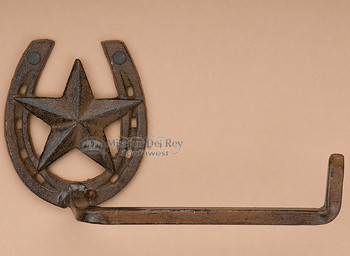 Western iron art toilet paper holder.