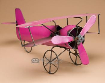 Recycled metal yard art - crop plane.
