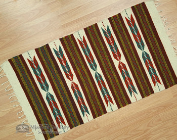 """Woven wool rug. 23"""" x 39"""""""