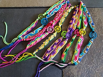 Assorted macrame dreamcatcher bracelets in various colors