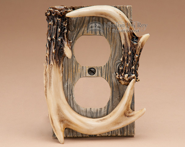 Faux antler plug outlet cover.