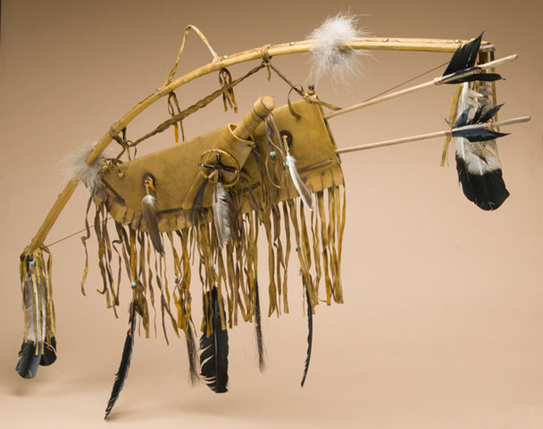 Antiqued Native American bow, arrow and quiver set with bone knife included.