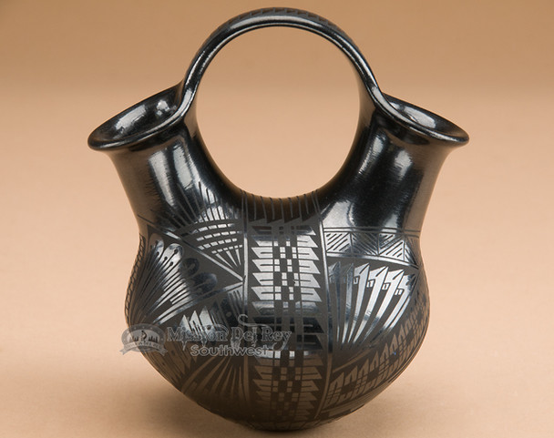 Mata Ortiz polished black wedding vase.