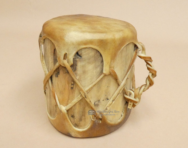 Tree trunk drum with rawhide