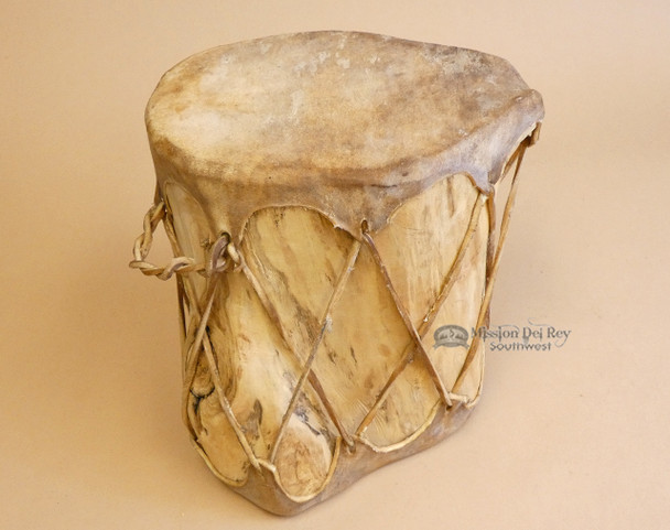 Tree log drum with leather face and lacing
