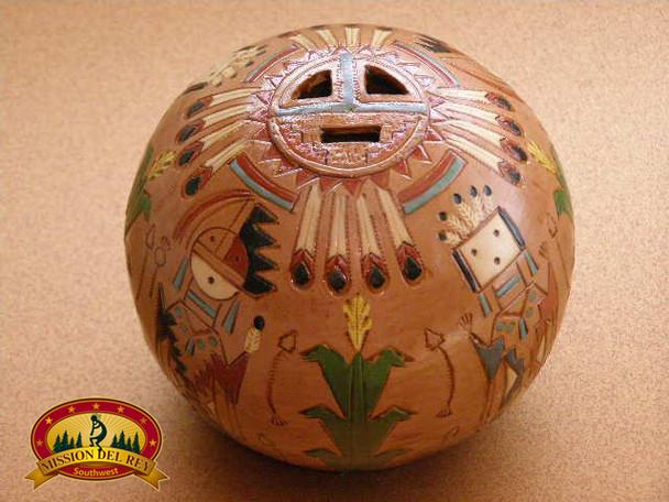 Hand tooled Navajo Indian clay pottery vase.