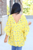 Model wearing Yellow Floral Button Up Babydoll Top Back View