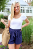 Model wearing Navy Paperbag Waist Shorts Front View