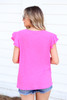 Model wearing Neon Pink Ribbed Ruffle Sleeve Top Back View