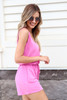 Model wearing Fuchsia Sleeveless French Terry Romper Side View