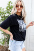 Model wearing Black Dreamers Wanderers Floral Graphic Tee Side View