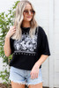 Model wearing Black Dreamers Wanderers Floral Graphic Tee Front View